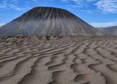 The inspiring black Sand Sea the surrounds the active volcano Bromo - East Java