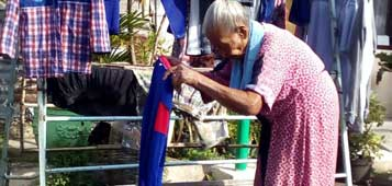 Mrs. Munir - washing & toilet lady in Kampong Klojen