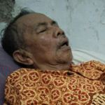 Mr. Slamet on his bed - hit by a stroke in February 2018