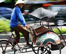 Becak driver - easy mode of transport in East Java